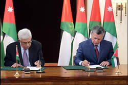 Mahmoud Abbas and King Abdallah sign the agreement reconfirming Jordan's role in responsibility for the Muslim and Christian holy places in Jerusalem (Wafa News Agency, March 31, 2013).