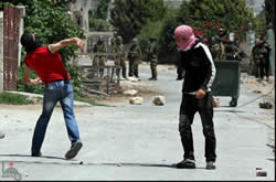 Palestinian youths throw stones and IDF forces during the weekly demonstration in the village of Qadoum (near Qalqiliya) (Wafa News Agency, June 21, 2013).