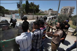 Palestinians confront IDF forces at Ma'sara (Bethlehem district) at one of the weekly riots protesting the security fence and the settlements (Wafa News Agency, June 28, 2013).