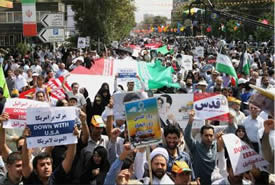 "The demonstration in Iran. The red posters read ""Down with Israel"" (Press TV Facebook page, August 2, 2013)."