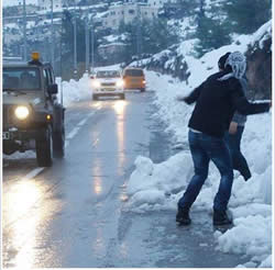 Palestinians throw stow balls at IDF vehicles (Fatah bureau of enlistment and organization Facebook page, December 11, 2013).