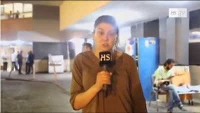 A correspondent from the Finnish TV channel HS-TV reports on rocket fire from close proximity to the Al-Shifa'a Hospital