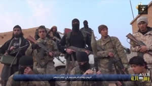 From the video: The French-speaking masked man in the center, flanked by other ISIS operatives
