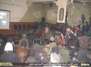 Photo presented by ISIS from the town of Al-Hajar al-Aswad (south of Damascus), documenting a public news broadcast produced by ISIS for the residents of the town  (Al-Minbar, January 26, 2015)