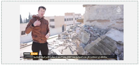 John Cantlie against the background of a ruined building allegedly located in Aleppo, which might actually be in the city of Al-Bab, east of Aleppo (shabakataljahad.net)