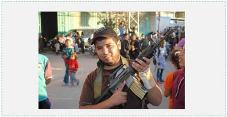 """Journalist"" Ezat Salameh Doheir, wearing a PIJ/Jerusalem Brigades cap and armed with an M-16 rifle (Ardh Knaan website, December 25 2014)."
