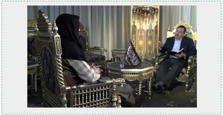 Abu Muhammad al-Julani (left) appears in a rare interview on Al-Jazeera TV  (Al-Jazeera, May 17, 2015).