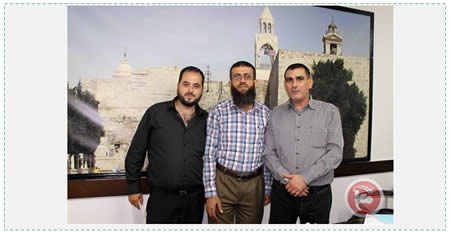 Nasser Laham (right), Ma'an's the editor-in-chief, and Muhammad Faraj (right) manager of the Ma'an satellite TV channel. They hosted senior PIJ operative Khader Adnan (center) in their offices in Bethlehem (Ma'an News Agency, September 1, 2015).
