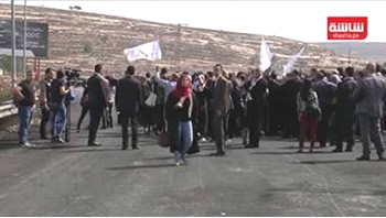 "Members of the Palestinian Bar Association advance towards Israeli security forces at the so-called ""Courthouse Roadblock"" near Beit El, during a show of solidarity with Palestinian terrorist operative Muhannad Halabi. He was the Palestinian terrorist who carried out a stabbing attack in Jerusalem, killing two and wounding two (YouTube, October 12, 2015)."