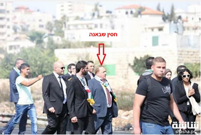 "Hussein Shabaneh (arrow), chairman of the PA bar association, marches at the head of a protest march to the ""Courthouse Roadblock"" (PBA website, October 12, 2015)."