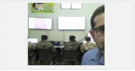 The Syrian-Iranian operations room set up in Aleppo before the Syrian army attack, waged with the support of Iranian fighters. The poster in the upper left hand corner shows Khamenei, Khomeini and an unidentified third person. The Persian text at the right reports on the operation room's activities (Fars News, October 22, 2015).