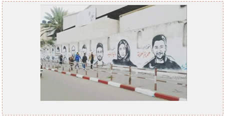 Glorifying the terrorists who carried out attacks in the current terrorist campaign, on a wall in the western part of Gaza City (Facebook page of Shihab, December 11, 2015).