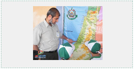 """Educating"" the younger generation with maps: A counsellor in a Hamas summer camp in the Gaza Strip points to a map of ""Palestine"" issued by Hamas which ignores the existence of the State of Israel (Filastin al-A'an, June 8, 2016). Important Israeli cities do not appear on the map. Jaffa, considered a ""Palestinian city,"" replaces Tel Aviv, and Um-Khaled, an Arab village which no longer exists, replaces Netanya."