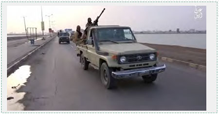 ISIS operatives drive along a coastal road in Yemen, apparently in the region of the port city of Aden (dailymotion.com, February 21. 2016)
