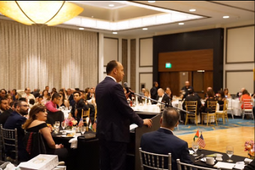 Husam Zomlot delivers a speech at the annual of conference of the Bethlehem Association in the United States (Facebook page of Husam Zomlot, August 6, 2017).