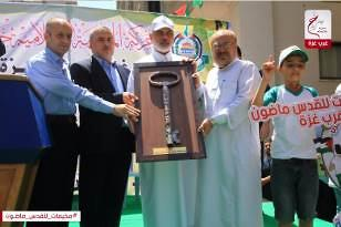Isma'il Haniyeh, head of the Hamas' political bureau, attends the opening of the summer camps in the western part of Gaza City (siraj lil-i'lam, July 9, 2017).