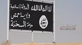 "An ISIS sign that reads ""The Islamic State, Homs Province, the City of Al-Sukhnah."""