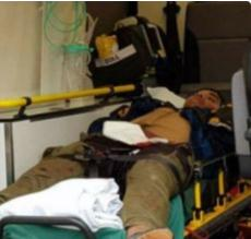 The perpetrator of the stabbing attack in Turku, Finland, lying on a stretcher in an ambulance after being shot in the lower body by local police (Twitter, August 18, 2017)