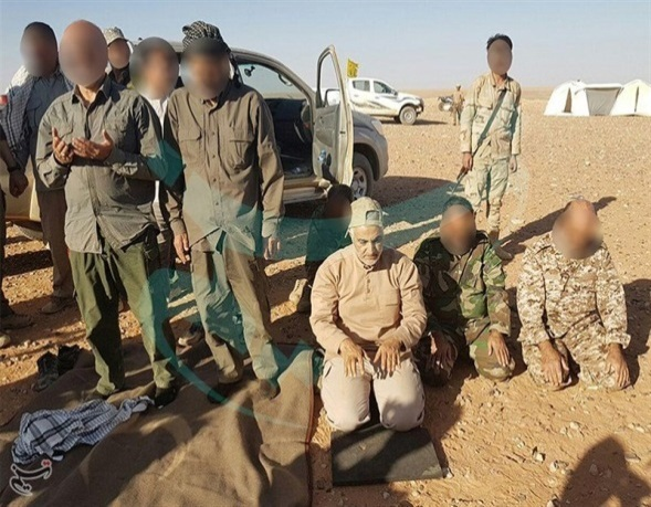Qasem Soliemani alongside Fatemyoun Brigade fighters near the Iraq-Syria border (Tasnim, June 12, 2017)