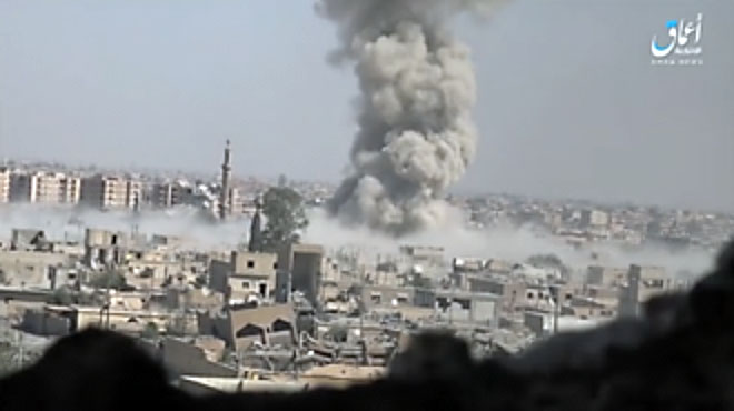 e billowing from the explosion of an ISIS car bomb, which hit a gathering of SDF forces near the Al-Barazi Square (Aamaq, 9 September 2017).