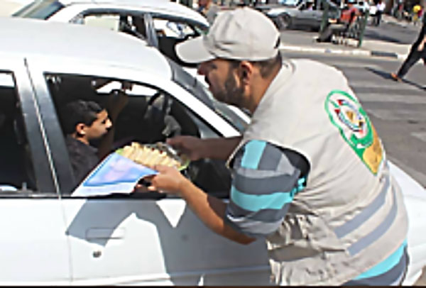 Hamas operatives in the Gaza Strip distribute pastries and candy to celebrate the shooting attack in Har Adar (Palinfo Twitter account, September 26, 2017).
