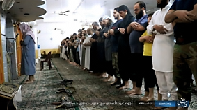 ISIS operatives praying in a mosque in south Damascus during Eid Al-Adha. A light weapon can be seen laid on the carpet in the mosque.