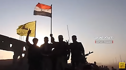 Hezbollah fighters waving the flags of the organization and Syria, following the capture of the airport (battle information institute of the Syrian Army, 11 September 2017).