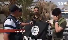 Civilians in 'Anah hold an ISIS flag upside down to show its defeat (al-Hura, September 23, 2017).