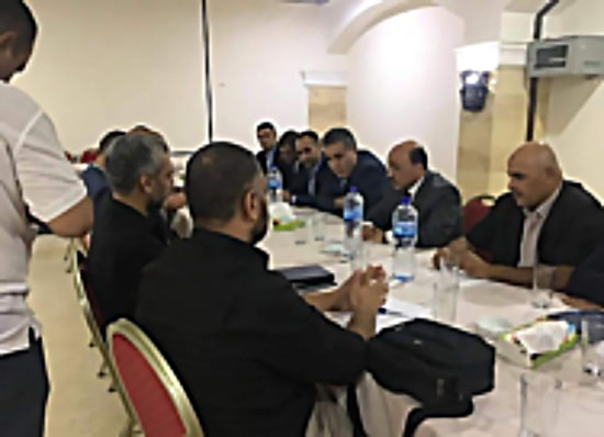 A delegation of PA security force operatives, headed by minister of housing Mufeed Hasayneh, meets with Hamas security force operatives in the Gaza Strip (Palinfo Twitter account, September 29, 2017)