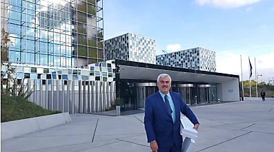 Shawan Jabarin, holding the report before submitting it to the ICC in The Hague (Al-Haq website, September 20, 2017).
