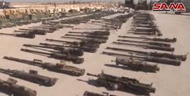Right: ISIS's anti-aircraft guns. Left: Anti-tank rocket launchers (SANA YouTube account, October 19, 2017)