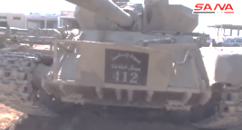 "ISIS's tank, with the inscription ""Islamic State, Caliphate Army 412"""