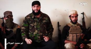 Abu Mohammad Al-Julani (center) speaking to Headquarters for the Liberation of Al-Sham operatives. The date this segment in the video was shot is unknown (Al-Sada YouTube account / Vedeng News, October 19, 2017)