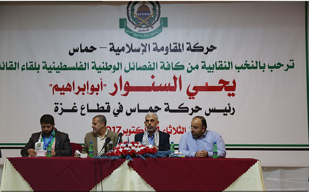 At his left (tan suit) is Dr. Suhail al-Hindi, a member of Hamas' political bureau in the Gaza Strip and formerly chairman of UNRWA's Palestinian staff union in the Gaza Strip, who was forced to leave his position after his affiliation with Hamas was exposed (Palinfo, October 24, 2017).