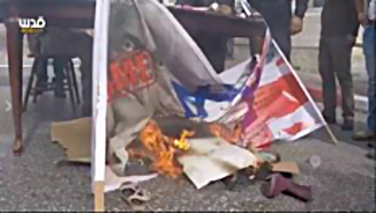 Burning the Israeli and British flags and a picture of Lord Balfour during a demonstration held at the northern entrance to Bethlehem (Facebook page of QudsN, November 1, 2017).