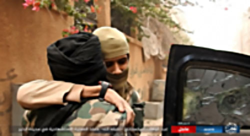 ISIS suicide bomber Abd al-Wahhab al-Turkestani bids farewell before leaving for the attack.