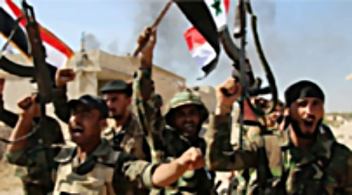 Syrian army soldiers wave Syrian flags and rifles after taking control of Deir al-Zor.