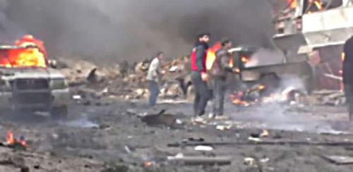 The scene of the car bomb explosion at the location for Deir al-Zor deportees (Syrian TV, November 5, 2017).