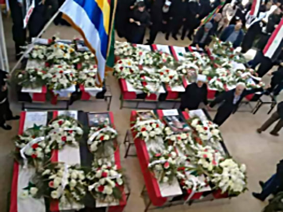 The coffins of the 16 victims of the car bomb in the Druze village of Hader (Twitter account of lamloma@lamloma3, November 5, 2017)