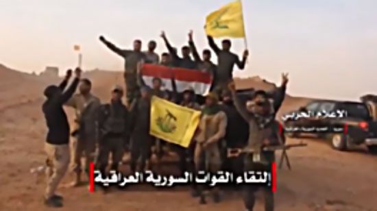 The flags of Al-Nujaba Movement, Hezbollah, and Syria, waved in a group photo at the point where they joined forces before the encirclement of Albukamal (Twitter account of Hezbollah's Military Spokesman's Office, November 8, 2017)