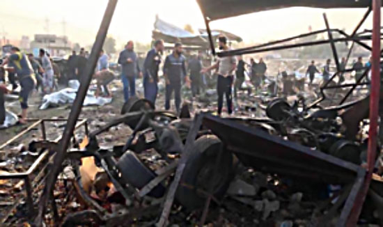 The scene of the car bomb explosion in a vegetable and fruit open market in the city of Tuz Khurmatu (Al-Jazeera, November 21, 2017)