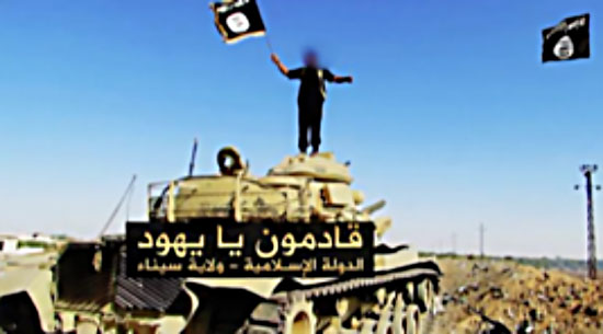 "ISIS's threat to Israel: An operative of the organization waving the ISIS flag on a tank, with the caption: ""We are coming, O Jews. The Islamic State – Sinai Province"" (Haqq, November 20, 2017)"