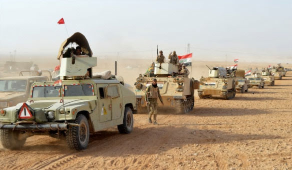 Iraqi army bullet-proof Humvees and APCs in the desert area during the mopping-up operation (Al-Baghdadia News, November 26, 2017).
