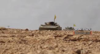 Two armored vehicles flying the Hezbollah flag east of the T2 oil field near the Syrian-Iraqi border (from a video produced by the Syrian institute for combat information, posted to the Murasiloun website, November 4, 2017).
