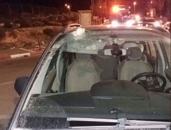 Israeli vehicles damaged by stones thrown by Palestinians near the village of Husan west of Bethlehem