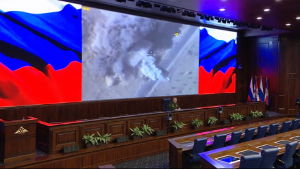 Sergey Rudskoy at the press conference. In the background, videos of the Russian airstrikes (website of the Russian Defense Ministry, December 7, 2017)