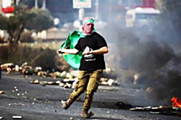 Palestinian throws a Molotov cocktail. Left Rocks and stones for throwing at IDF forces