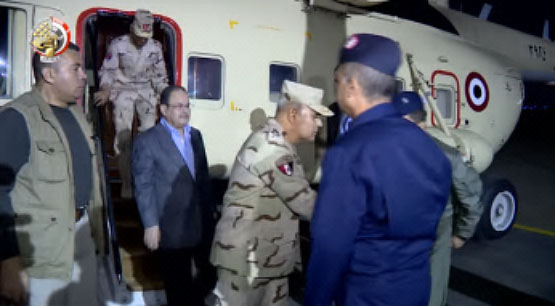 The Defense Minister (center) and Interior Minister (left) upon their return from the Al-Arish airport (YouTube Channel of the Egyptian Defense Ministry, December 19, 2017)