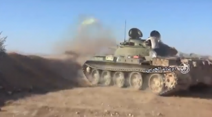 A Syrian army tank attacks targets of the Headquarters for the Liberation of Al-Sham around the village of Balil.