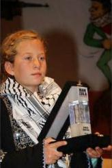 Ahed Tamimi receives a prize for courage at a ceremony held in Istanbul(al-Anadolu News, December 27, 2017).